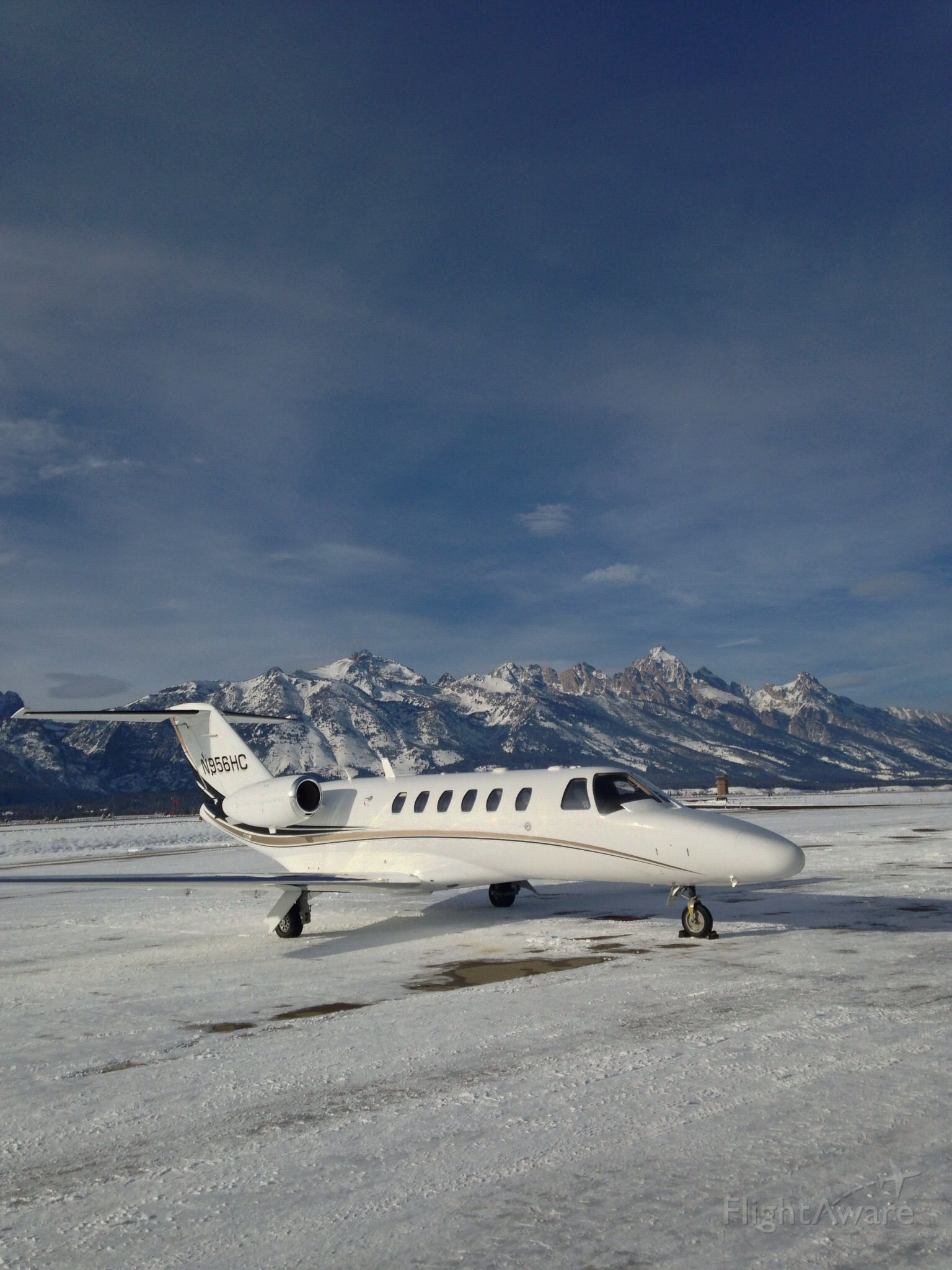 Cessna Citation CJ2+ (N956HC) - At Jackson Hole with Grand Teton in the background.