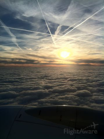 Boeing 737-700 — - Over France. Cloud formations