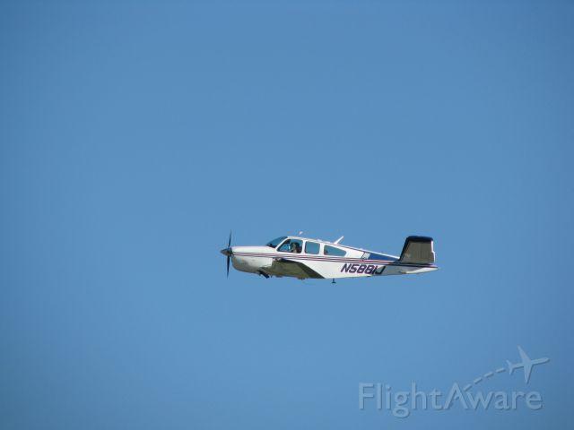 Beechcraft 35 Bonanza (N5881J) - Bananza departing 22 heading to a fly-in breakfast.