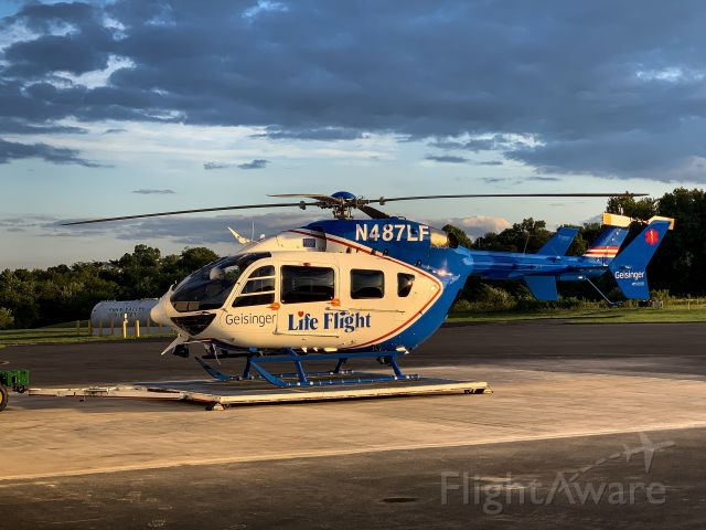 KAWASAKI EC-145 (N487LF) - GEISINGER LIFE FLIGHT coming back to base in Selinsgrove, PA after a night flying with 4 onboard. Check out that beautiful backdrop whilst resting on the transporting pad.