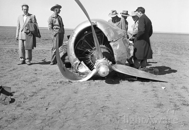 N65143 — - Surveying No 1 engine (P&W R-2000) that fell off DC4 as a result of in flight fire. Hugoton, Kansas, Mar 26, 1952. Photographer unk,from discarded Braniff accident files