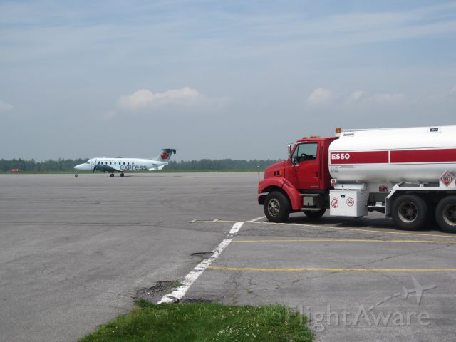 Beechcraft 1900 (C-GORA) - This dedicated to all those who yearn to fly, like this fuel truck