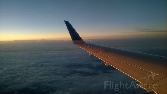 Embraer ERJ-145 — - Just departed KRIC for KIAH on ASQ4339 on September 7. We got above the clouds, and this was my view from seat 23A as the sun was rising.