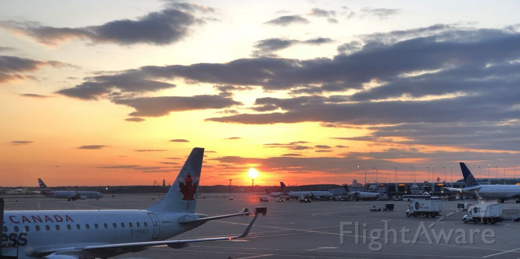 Embraer 175 (C-FEKJ) - Walking through terminal at ORD and saw this out a window, had to share. Chicago, 7pm.