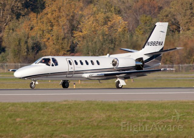 Cessna Citation II (N982NA) - Roll out after a smooth landing on runway 28. Speed brakes and thrust reversers deployed.