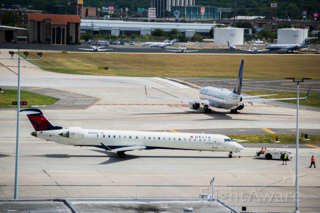 Canadair Regional Jet CRJ-900 (N162PQ) - pushing back before taxiing to runway 4. 9/4/19.