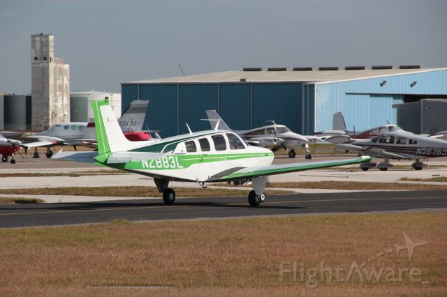 Beechcraft Bonanza (36) (N2883L) - Plane arrive and taxing back to parking spot at Peter O' Knight... Taken from helipad.