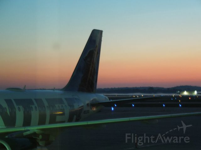 Airbus A319 (N933FR) - Preparing for an early morning departure to DEN.