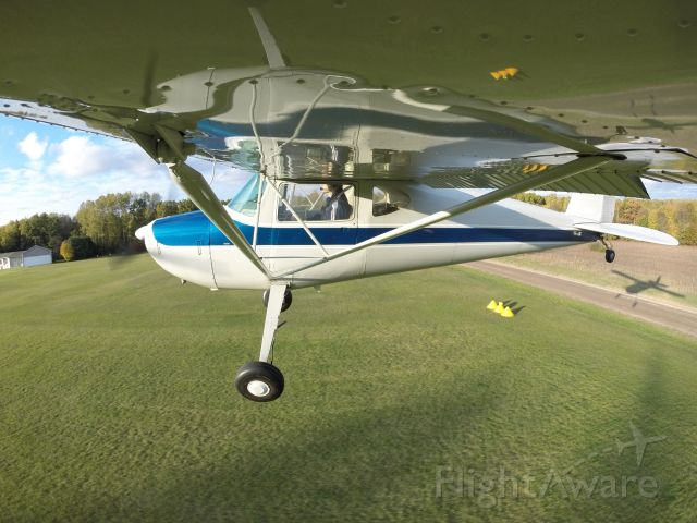 Cessna 140 (N2305V) - Fall flying at Wilderness Airport in Michigan.  Nice shadow and wing reflection.  GoPro camera