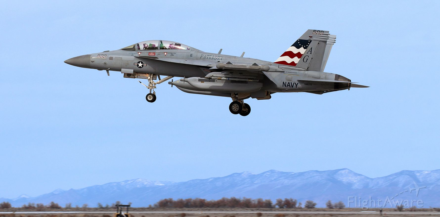 """McDonnell Douglas FA-18 Hornet (16-8375) - United States Navy Boeing E/A-18G Growler (168375)<br />VAQ 140 (Electronic Attack Squadron One Four Oh) """"Patriots""""<br />Current Home Port: NAS Whidbey Island, WA<br />Assigned to the USS George H.W. Bush (CVN 77) .... Carrier Air Wing Seven (CVW 7)<br /><br />The VAQ 140 """"Patriots"""" CAG colorbird landing on 31L after participating in a combat training sortie."""