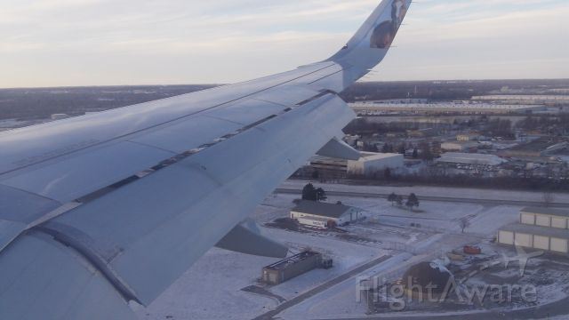 """Airbus A320 (N307FR) - Snowy Landing on Christmas Day 2017 at Indianapolis International Airportbr /""""White Christmas"""""""