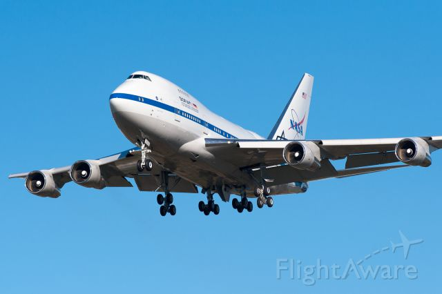 BOEING 747SP (N747NA) - NASAs SOFIA B747-SP flying telescope on short final for Christchurch International Airport, after a long flight southward from Hawaii on Monday 6 June 2016. She will be based in Christchurch for 8 weeks, for the long winter nights touring the Southern Ocean at >FL400.  Shot with my Nikon 300mm/f2.8 telephoto on a D700.