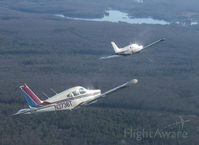 Piper Cherokee Arrow (N3736T) - Bernie Velivis (36T) and Jack Cunnif (98T) flying in loose formation near Nashua NH. Brian Carr took the picture while flying his Piper Dakota.