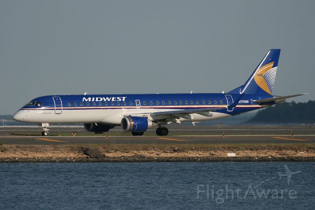 Embraer ERJ-190 (N170HQ) - Midwest E190 taxiing on 'November' to runway 22R for departure. May 20, 2010