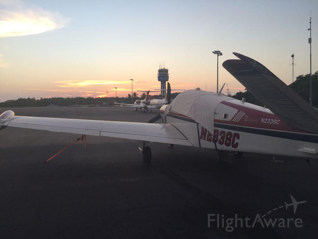 Beechcraft 35 Bonanza (N233SC) - My Bo sitting on the GA ramp in ZIH at sunset.