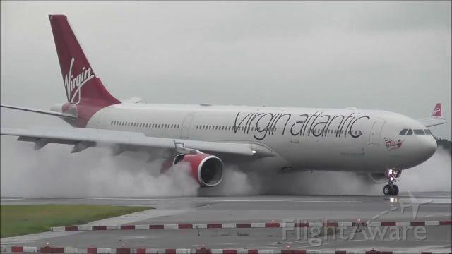 Airbus A330-300 (G-VWAG) - RW23R landed in a raining day from Bridgetown Barbados Island