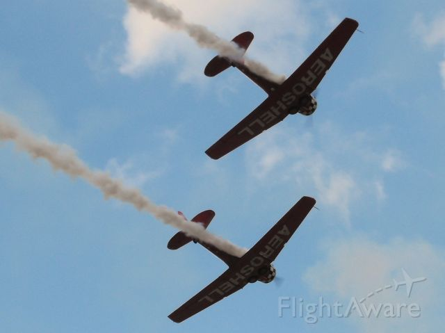 North American T-6 Texan (N3267G) - A great view from GA Camping of the Aeroshell T-6 Texans at Sun-N-Fun 2016