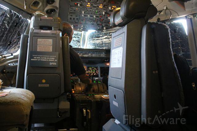 McDonnell Douglas DC-10 (N330AU) - Orbis.org, Mechanic checks cockpit displays, during #2 Engine run up on the tarmac