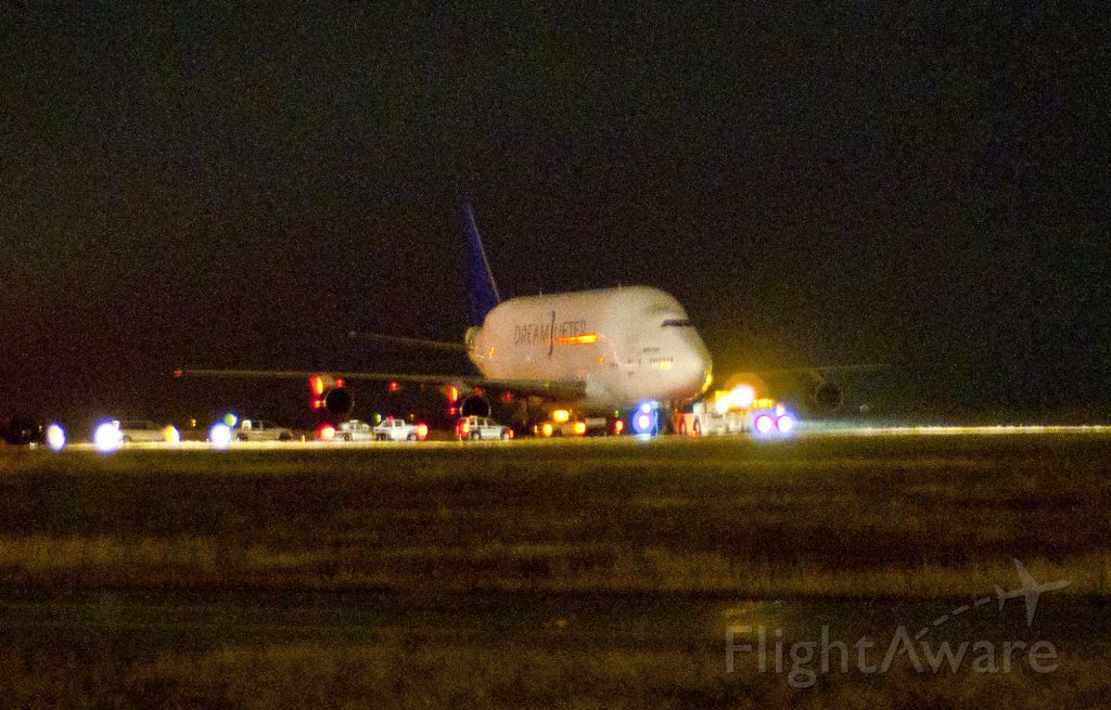 Boeing 747-400 — - The Dreamlifter landed at KAAO instead of KIAB.  According to local media, ATC radio recordings indicate that the pilot thought they had landed at KBEC.  KAAO has a runway length of 6101.  This photo was taken from HWY K-96.  The aircraft is at the south end of the runway.