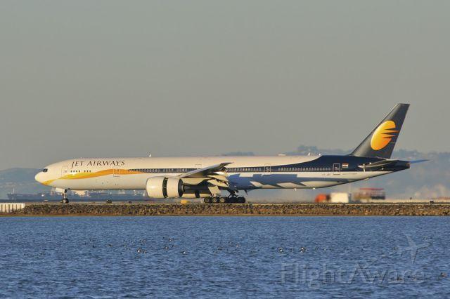 BOEING 777-300ER (VT-JEF) - Landing--reverse thrust at SFO after completing a Mumbai-Bangkok-San Francisco trip.