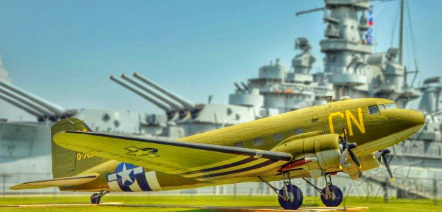 Douglas DC-3 — - USS Alabama sits in the background of this old bird...
