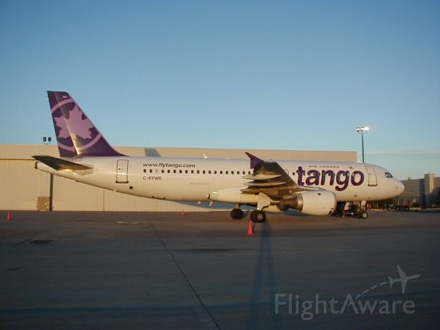 Airbus A320 (C-FPWE) - One of the first Tango branded aircraft in 2003 in Denver on a NHL Charter.