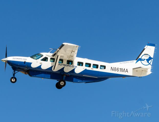 Cessna Caravan (N861MA) - TOA captain giving me a flyby in the vab at GHC/MYBG