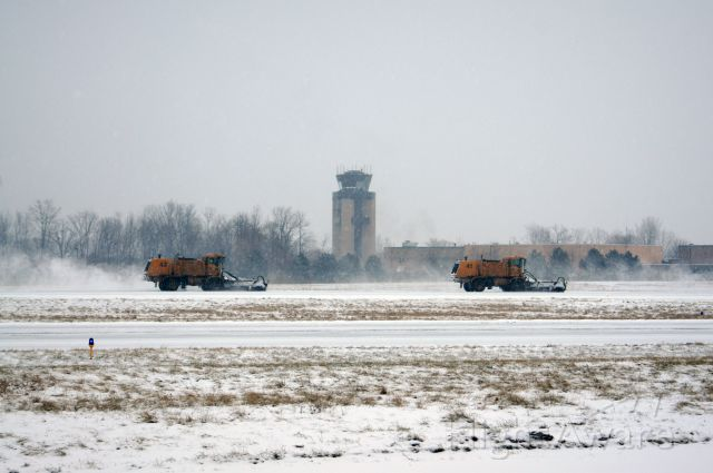 — — - Removing snow on RWY 19 during todays storm
