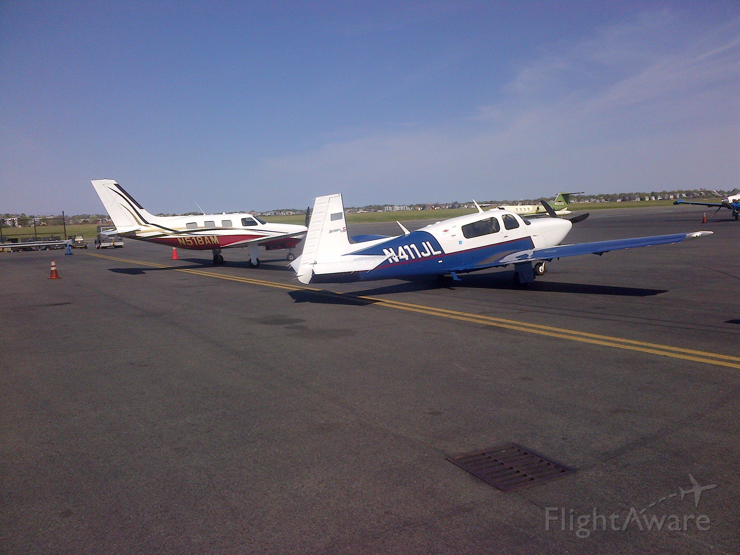 Piper Malibu Mirage (N518AM) - Unexpectedly meeting up with Big Daves Piper on the flight line at Logan.