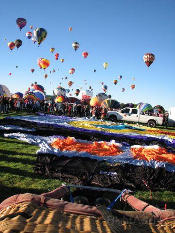 Unknown/Generic Balloon — - Brazilian Coruja owl balloon preparing to be inflated. 2014 Albuquerque International Balloon Fiesta. October 4, 2014.