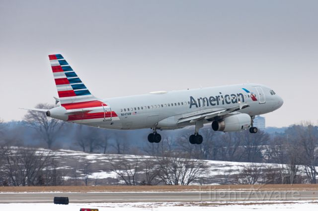 Airbus A320 (N647AW) - An American Airlines flight from Phoenix Sky Harbor International Airport landing in Des Moines. This shot was taken from a newly discovered place at DSM. Shot with a Canon EOS 50D at 300mm, 1/400, 160 ISO, F/10.