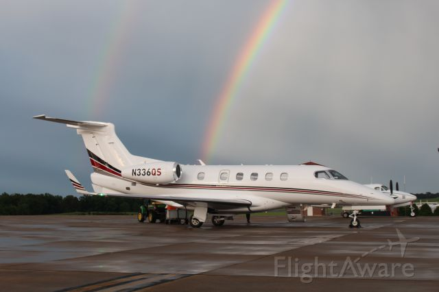 Embraer Phenom 300 (N336QS) - God was on my side when I took this photo. Just minutes before some family of mine boarded this Embraer Phenom, two rainbows appeared behind it.