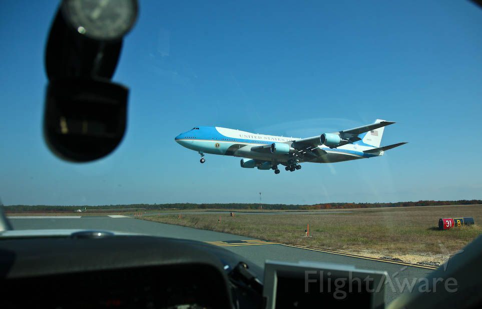 Boeing 747-200 — - Air Force One Aircraft on very short final Atlantic City Airport. Point of view from cockpit holding short for departure.