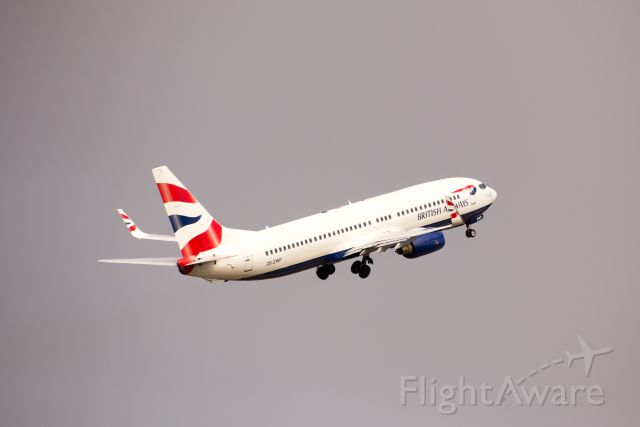 Boeing 737-800 (ZS-ZWP) - (Click Full) On a miserable day back in May (3 May) this British Airways B737-86N Next Gen (operated by Comair) flight CAW6241 retracts gear after departing out west from PLZ (FAPE) on runway 26 headed for JNB (FAOR).