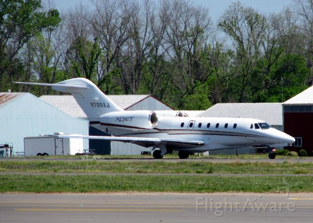 Cessna Citation X (N765XJ) - About 3 seconds from lift-off on runway 14 at Downtown Shreveport.