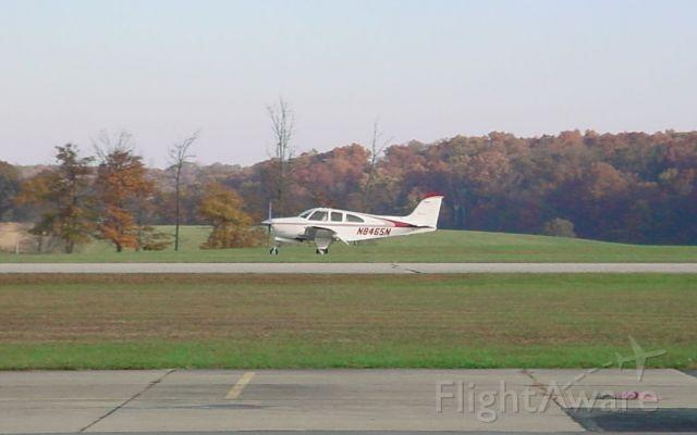 Beechcraft Bonanza (33) (N8465N) - Landing rwy 27 on 10/29/09