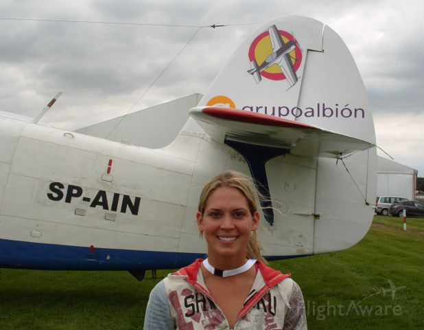 SP-AIN — - EGBV is Silverstone, England. Type is Antonov An-2. Photo taken on 18AUG2009. c/n 1G210-27. Melissa Pemberton poses in front of the AN-2 prior to commencement of the World Aerobatic Championships (WAC) 2009. Melissa, who is also known under her maiden name of Andrzejewski, was granted a hors concours (H/C), which basically meant she was in the Championships as a non-competitive entry. However, despite being so young, she did very well and would have finished 36th out of a total entry of 59 had she been competing. She used Extra 300S N600YS which was also used by Norbert Werle of the German team and Gabi Schifferle of the Swiss team. Operated by Unlimited Aerobatics - Grupo Albión.