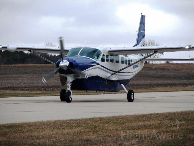 Cessna Caravan (N942AC) - WBR(Air Choice One) taxiing in at KMCW
