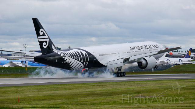 BOEING 777-300 (ZK-OKR) - BOE56 from KARA makes tire smoke on landing Rwy 16R on 5/23/14. (LN:1206 / cn 44546).