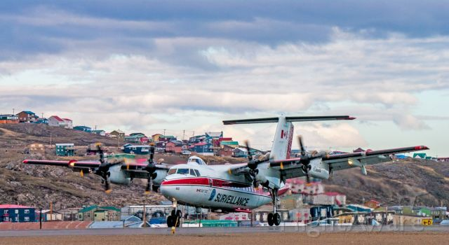 De Havilland Canada Dash 7 (C-GCFR) - Landing at Iqaluit Airport in Nunavut C-GCFR DeHavilland Canada DHC-7-102 Dash7 on JUN.16.2017. Beautiful Spring Day with Iqaluit as the backdrop. This is the only plane in the world like this.