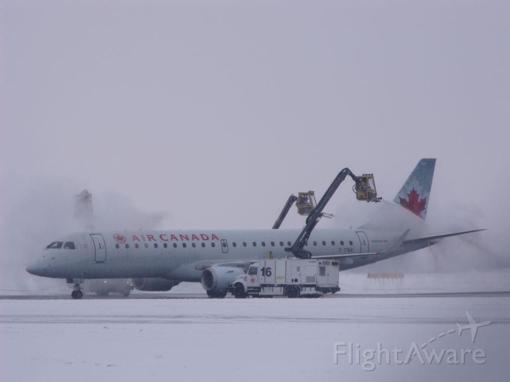 Embraer ERJ-190 (C-FNAI) - being deiced before leaving Ottawa.