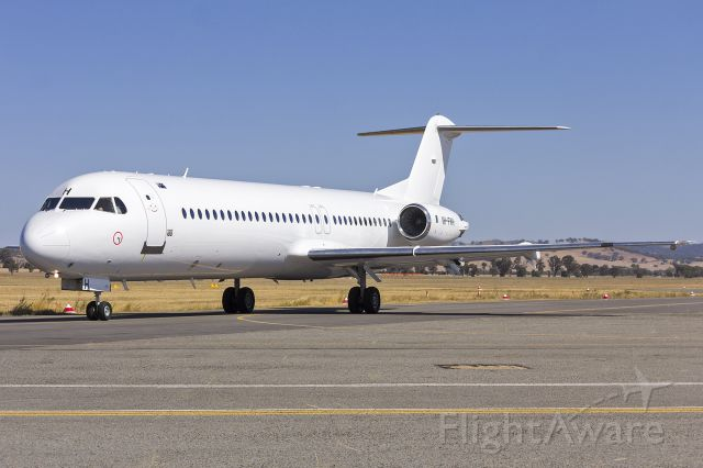 Fokker 100 (VH-FWH) - Alliance (VH-FWH) Fokker 100, now repainted white, taxiing at Wagga Wagga Airport.