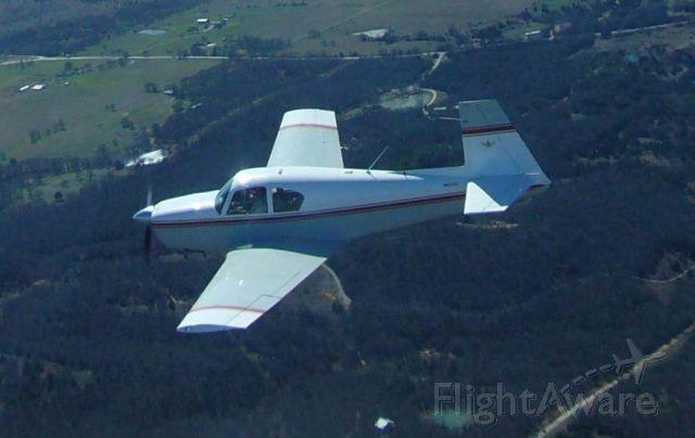 Mooney M-20 (N6030X) - 1960 Mooney M20A N6030X in flight near Gainesville, Texas