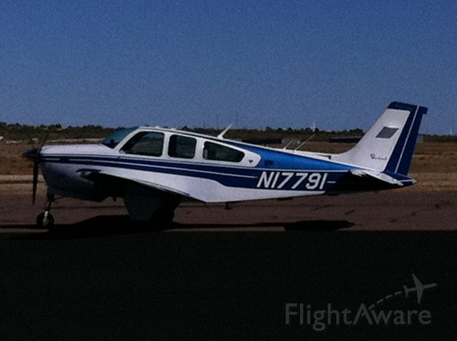 Beechcraft Bonanza (33) — - Blue over white
