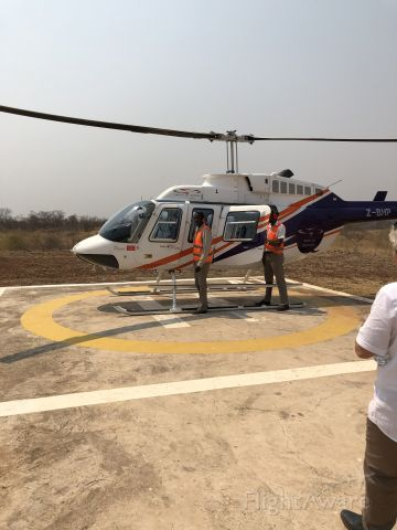 Z-BHP — - About to board for helicopter flight over Victoria Falls