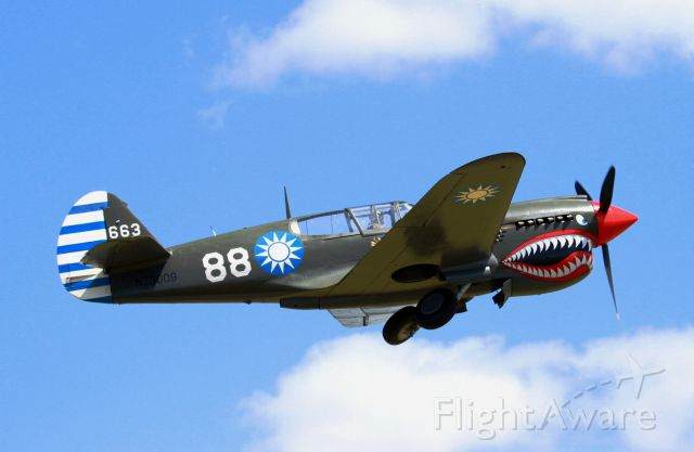 CURTISS Warhawk (ANZ3009) - Gear coming up on climbout.