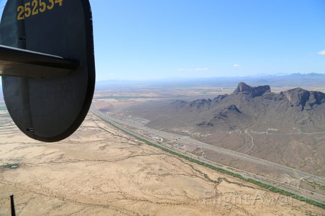 """Consolidated B-24 Liberator (N224J) - Collings Foundation """"Wings of Freedom Tour,"""" 9 Apr 16, at Marana Regional Airport, AZ.  B-24J, Witchcraft, NX224J.  Looking south at Picacho Peak and I-10 Exit 219."""