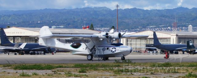 N222FT — - A Vultee 28-5ACF sits on the ramp at historic HIckam Air Base with the Waianae Mountains in the background, and KC-135s and a F-35 nearby.  This Catalina was on O'ahu for three weeks, culminating with the 75th Anniversary of VJ Day activities in which it took part.  This plane will be loaded onto the USS Essex and shipped back to the mainland.  The beautiful sound of its distinctive engines will be sorely missed on island.
