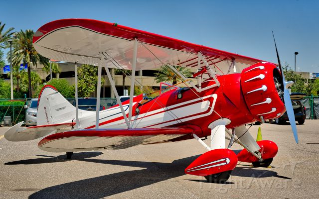 WACO O (N32005) - WACO UPF-7 built in 1941. Part of the lunch crowd at The Hangar Restaurant at Albert Whitted Field, St. Petersburg, Florida.