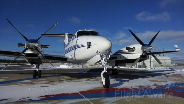 Beechcraft Super King Air 300 (N300MC) - 21 degrees on a sunny day in November.